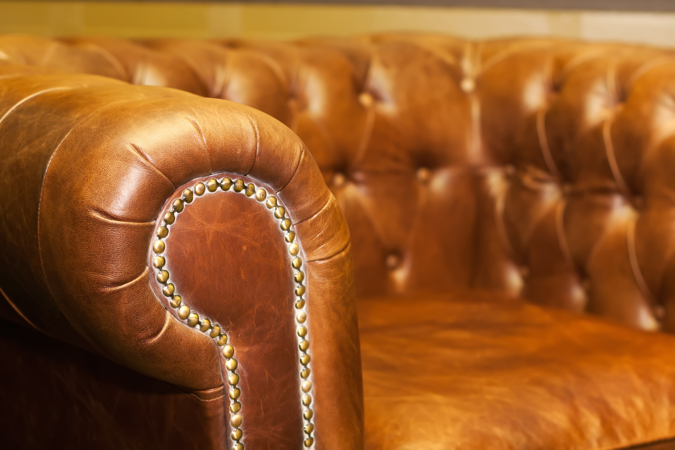 Close up of comfortable luxury leather sofa in the room